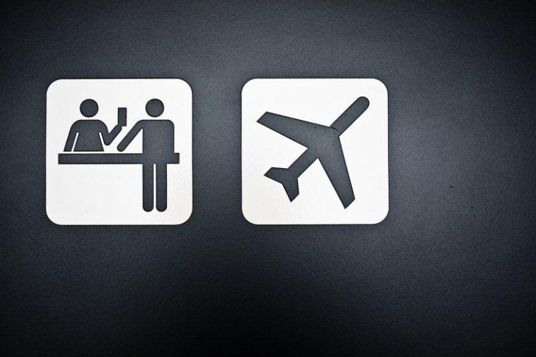 Close-up of signs at airport